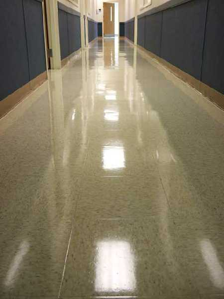 Floor With A Beautiful Shine After Buffing Shiny Waxed Hall